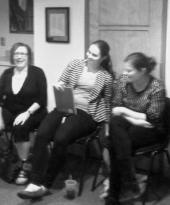 Laura (center) laughing with other members.